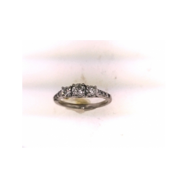 14 KARAT WHITE GOLD AND DIAMOND PAST/PRESENT AND FUTURE RING SET WITH 3 ROUND BRILLIANT DIAMONDS IN THE CENTER AND 6 SIDE ROUND DIAMONDS (ESTATE)