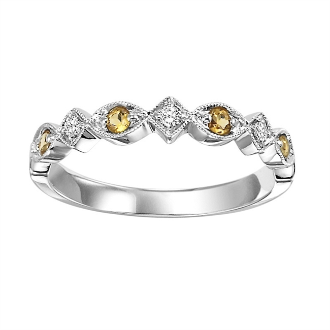 10 KARAT WHIT GOLD  MIXABLE RING SET WITH THREE  DIAMONDS .06 CARAT TOTAL WEIGHT  AND FOUR  CITRINES .13 CARAT